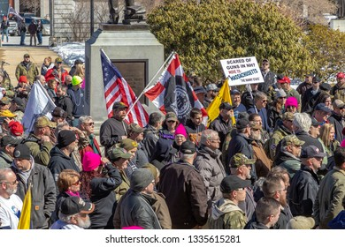 New Hampshire Gun Rights Rally at the Capital House in Concord, NH.  Saturday, March 9, 2019. Close up of the cloud holding flags.