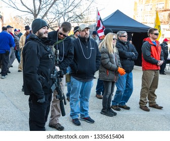 New Hampshire Gun Rights Rally at the Capital House in Concord, NH.  Saturday, March 9, 2019. Standing men are holding guns.