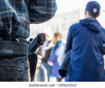 New Hampshire Gun Rights Rally at the Capital House in Concord, NH.  Saturday, March 9, 2019. A pistole in a person's pocket.