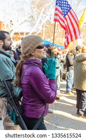 New Hampshire Gun Rights Rally at the Capital House in Concord, NH.  Saturday, March 9, 2019. A woman participant is carrying a raffle gun.