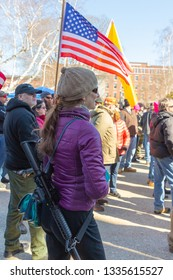 New Hampshire Gun Rights Rally at the Capital House in Concord, NH.  Saturday, March 9, 2019. A woman is carrying a gun.