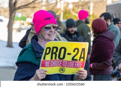 New Hampshire Gun Rights Rally at the Capital House in Concord, NH.  Saturday, March 9, 2019. A woman is holding a Pro constitutional Amendment 2 sign