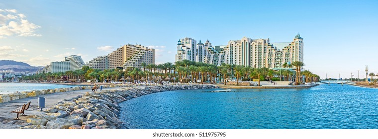 The new harbor with the scenic stone pier is the best place to overlook the center of the beautiful resort of Eilat, Israel.