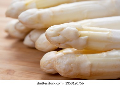 New harvest of white asparagus vegetable in spring season , washed white asparagus ready to cook close up, spring menu for restaurants