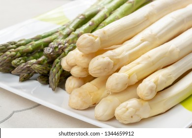 New harvest of white and green asparagus vegetable in spring season, washed asparagus ready to cook, spring menu for restaurants close up