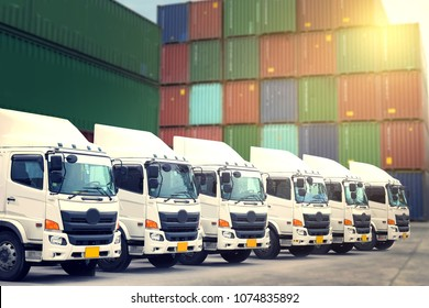 New haulage truck fleet in container depot as transporatation, shipping and logistics business.