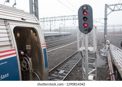 NEW HAVEN, CONNECTICUT - DEC. 21, 2018: Amtrak train waits in foggy overcast for diesel engine that will take the Vermonter into Vermont.