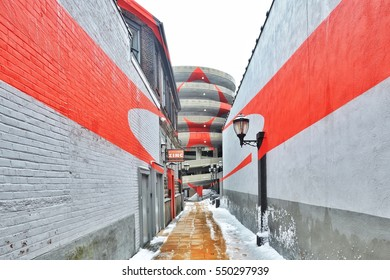 """NEW HAVEN, CT - CIRCA 2014: Felice Varini Installation titled """"Square with Four Circles"""" painted on the spiral ramp of a parking garage."""