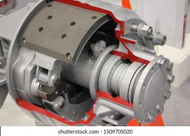 New heavy truck drum brake model closeup, brake pads on wheel hub with brake drum in cut, tutorial model