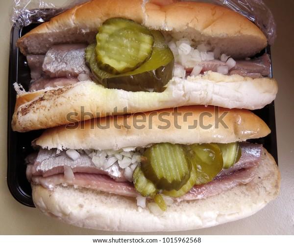 New herring bread roll, Dutch snack in Amsterdam