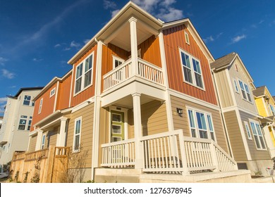 New home construction with balcony and porch in the walkable neighborhood of Mueller in Austin, Texas, USA.