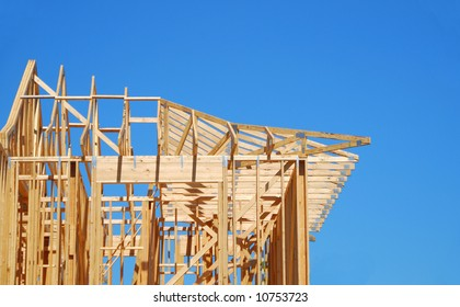 New home construction under bright blue sky