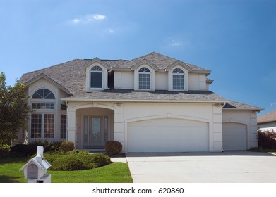 New home with an interesting roof line and lots of arched windows. One of many in my home series.
