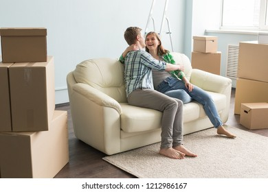New home, moving and real estate - Happy couple sitting on sofa and discussing new flat