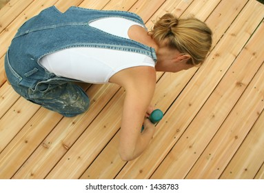 A new home owner builds her own deck to save money.