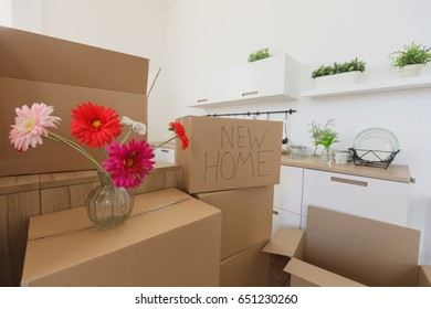 New home owners unpacking boxes, footage of big cardboard boxes in new home