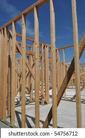 New Home Under Construction with Blue Sky and Foundation