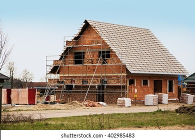 new home under construction, building a European style house, stone on stone