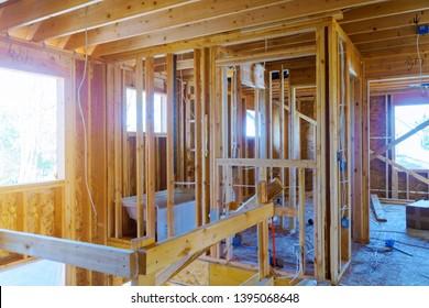 A new home under construction interior inside house frame.