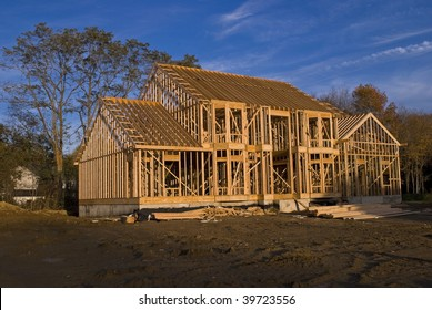 A new home under construction showing the all wood framing process.