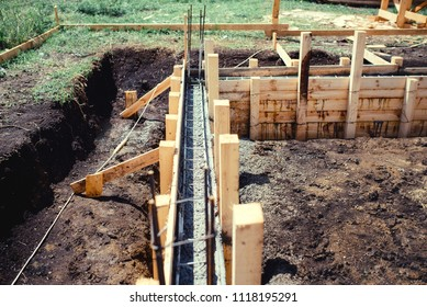 new house, building construction site, cement in foundation and reinforcement of steel bars