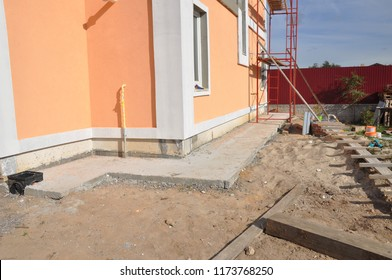 New house construction foundation waterproofing, damp proofing, insulation with contrete path to avoid water leaks for home wall.