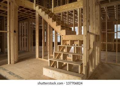 new house construction interior with exposed framing and stairs