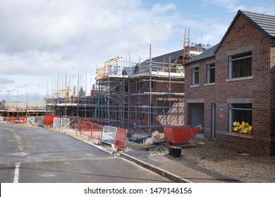 New house construction in UK, typical housing development with scaffold