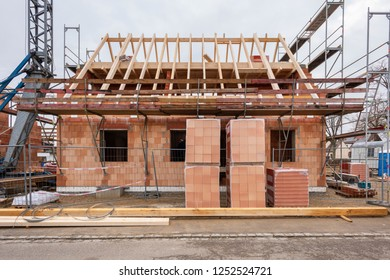 new house in construction with wooden roof