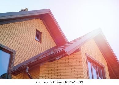 New house eaves on blue sky.