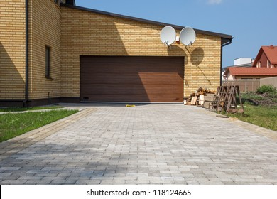 New house garage door with a paved paths