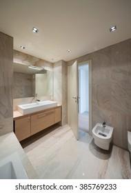 New house,  inside  the marble bathroom with basin modern design