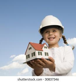 New house model on girl hands