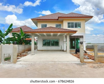 New house under construction in village with blue sky.