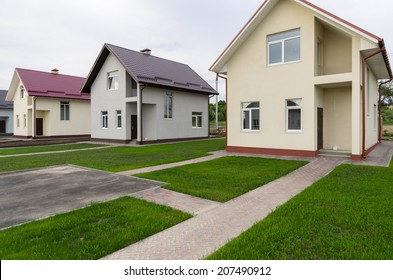 New houses with green grass near the road