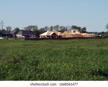 A new housing development encroaches onto rural land in southwest Missouri.