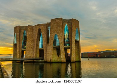 new iconic building in the inlet of the harbor, reflections in the sunrise, Vejle, Denmark, November 15, 2018