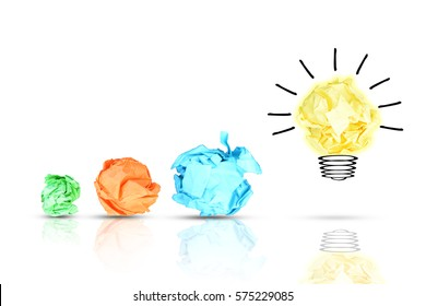 New idea concept with colorful crumpled paper and bulb on white background