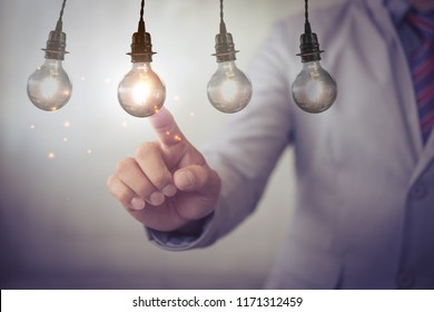 new idea creative idea.Concept of idea and innovation.Hand touch Light blub