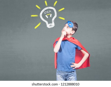 New idea, innovation and creativity concept with little super hero boy