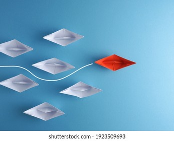 New ideas, creativity and various innovative solutions or leadership concept paper boats on a blue background
