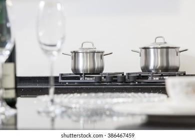 New iron pot on a black gas stove on a kitchen