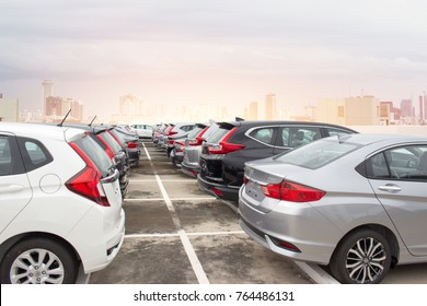 New Japanese cars  row  parked at a car dealership stock.