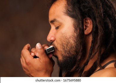 new jazz reed orleans rastafarian instrument rastafarian man playing mouth harmonica new jazz reed orleans rastafarian instrument color play colour brown emotion white harmonica nails hand face people