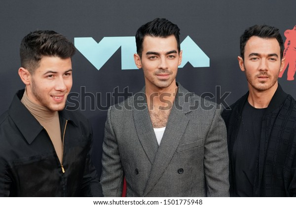 NEW JERSEY - AUGUST 26, 2019: The Jonas Brothers attend the MTV Video Music Awards at the Prudential Center on August 26, 2019, in Newark, New Jersey.