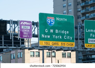 New Jersey, Circa 2017: Highway signs direct and inform drivers travel into Manhattan New York City via George Washington Bridge to pay dollar toll fee for crossing