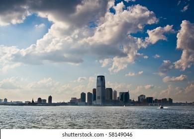 New Jersey city skyline under blue cloudy sky