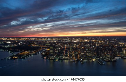New Jersey City skyline with urban skyscrapers at sunset.  					Photo taken from freedom tower Ground Zero observatory