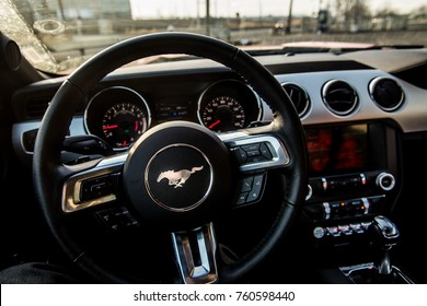 New Jersey, NJ, USA - October 14, 2017:  Driver's View on a steering wheel with Ford Mustang Logo in Interior of an American muscle car