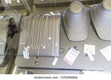 New Jersey, September 26, 2018:T.J. Maxx Retail Store Location. Necklace glass counter.T.J Maxx is a discount retail chain featuring stylish brand-name apparel, shoes and accessories III
